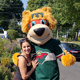 Girl posing with Nordy of the Minnesota Wild