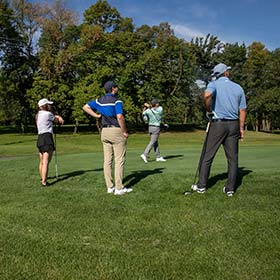 Golfers teeing off at Burl Oaks Golf Club
